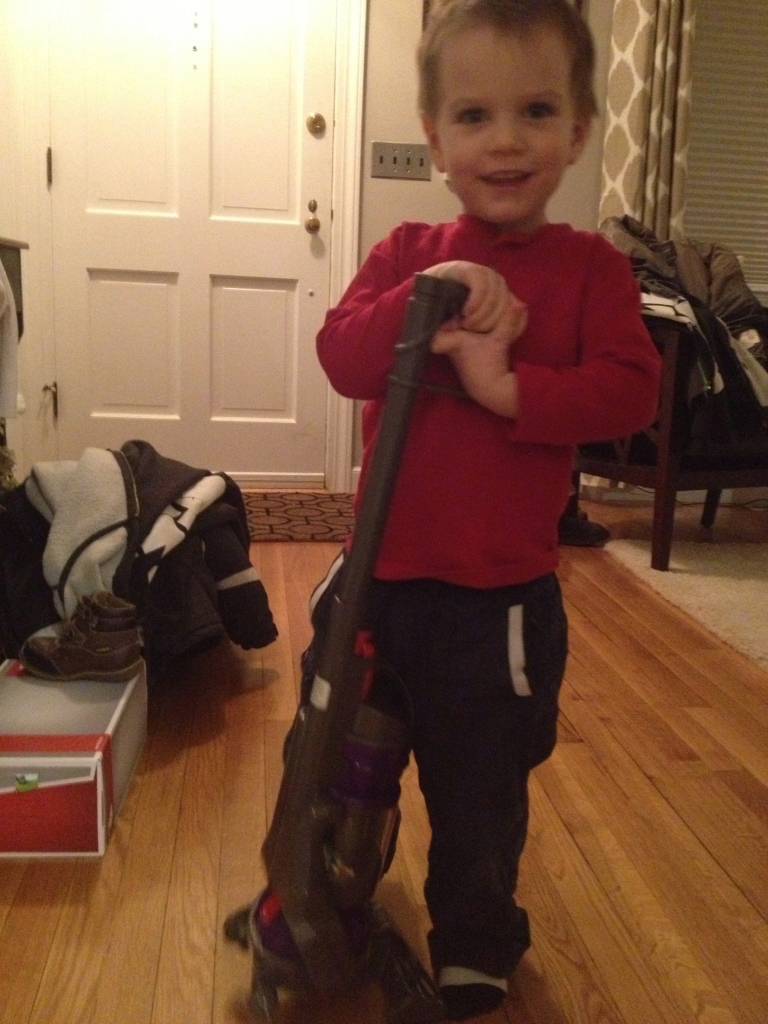 Leif Dizzle Davis got a vacuum for Christmas.  He's so happy :)