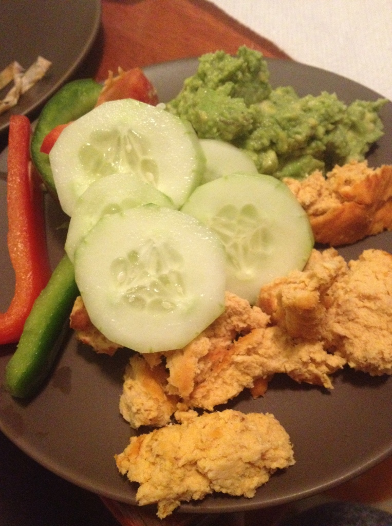 Super Bowl Sunday snacks.  Buffalo chicken dip, cucumber slices, bell peppers, guacamole