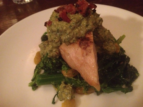 Misty Knoll Chicken on top of a cold Broccoli Rabe, Golden Raisins, Walnut and Kefir Pesto